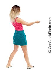 back view of standing girl pulling a rope from the top or...