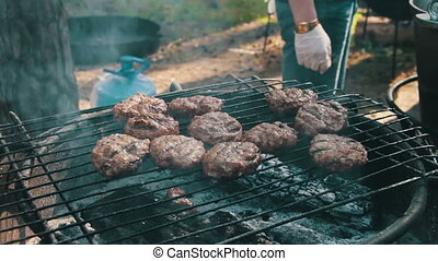 Meat for Burgers Prepared On The Grill. Burger meat grilled...