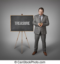Treasure text on blackboard with businessman - Treasure text...