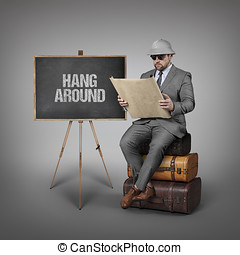 Hang around text on blackboard with explorer businessman -...