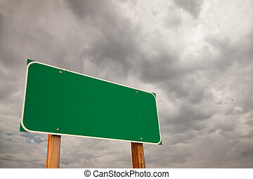 Blank Green Road Sign Over Storm Clouds - Blank Green Road...