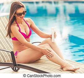 Beautiful girl at the pool - Beautiful girl in pink swimwear...