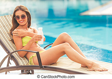 Pretty girl at the pool - Pretty girl in green swimwear and...