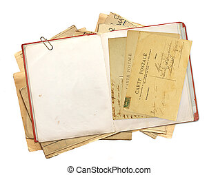 Old book and vintage post cards. Objects isolated on white...