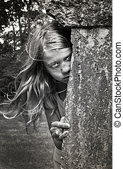 Headstone girl at halloween - Scary child next to a...