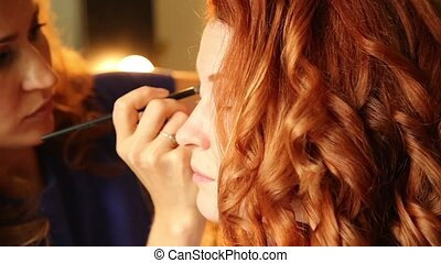 time in a beauty salon. redhead young woman in a beauty...
