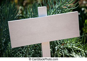 White wooden sign post in garden