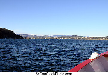 Annecy Lake and mountains from boat