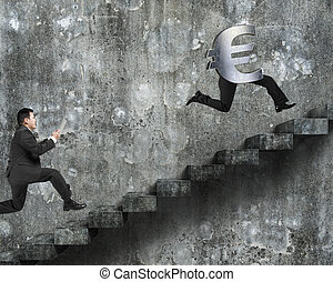 Man running after Euro money symbol with human legs, on old...