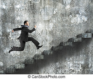 Man running on old dirty concrete stairs with wall...