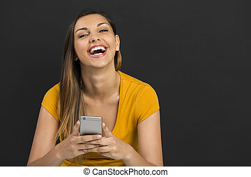 Girl with a smartphone - Beautiful woman sitting in the...