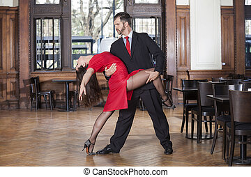 Professional Male And Female Tango Dancers Performing In...