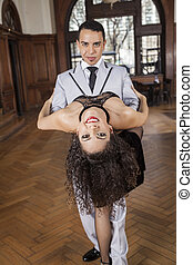 Female Dancer Bending Backwards While Supported By Man -...