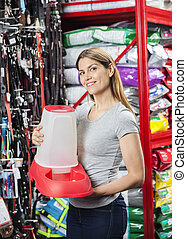 Happy Customer Holding Pet Food Bowl At Store - Portrait of...