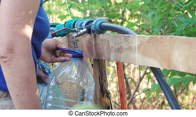 Filling plastic capacitance with water - Nature is filled...
