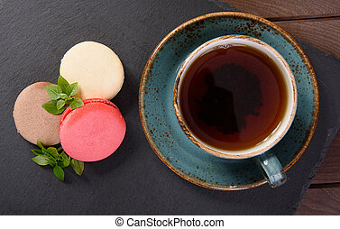 french sweet delicacy, macaroons and cup of tea
