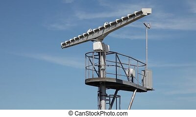 Marine traffic control radar tower with spinning antenna...