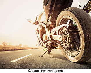 bike on freeway - motor bike on freeway to horizon