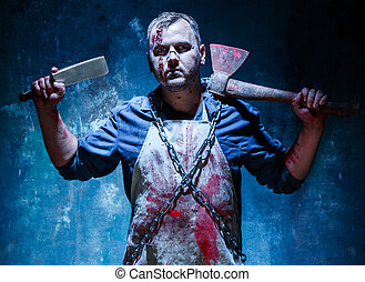 Bloody Halloween theme: crazy killer as butcher with an ax -...