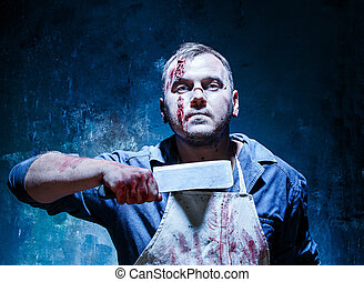 Bloody Halloween theme: crazy killer as butcher with a knife...