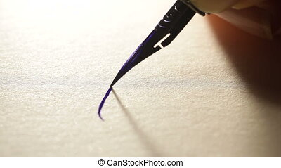 female hand writes a pen calligraphic signs.