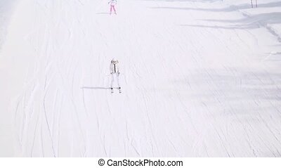 Ski track with chair lift, resort in mountains in...