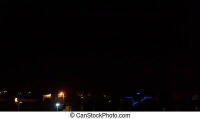 Lightning in night city sky
