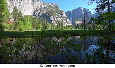 Yosemite Falls reflection in Merced River at Sunrise...