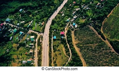 Aerial view on suburban road with cars, trucks and other...