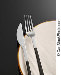 Dinner setting - Fork, knife and plate on black background