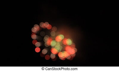 White, blueviolet, red and green circles of fireworks opening. Bokeh.