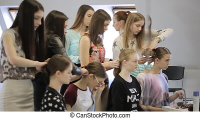 Young females in model school are preparing for lesson....