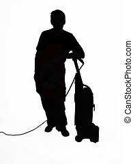 man leaning on vacuum