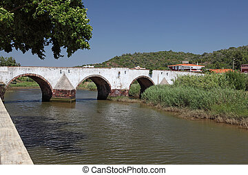 Ancient Roman bridge over Arade River in Silves, Algarve Portugal