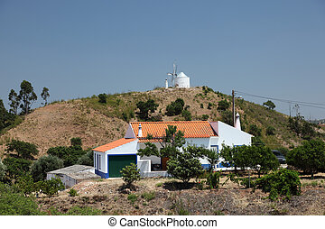 Rural house and windmill in Portugal