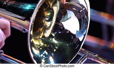 Closeup film of fragment trumpet. Instrument closeup on...