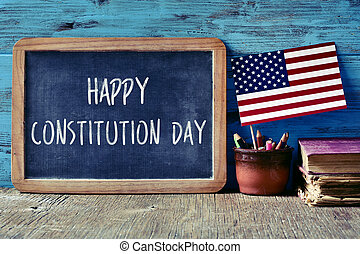 text happy constitution day and flag of USA - a chalkboard...