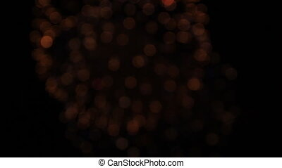 Red, white and red balls of fireworks opening one from another. Bokeh.