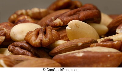 Mixed nuts close up while rotating - Mixed nuts pile close...