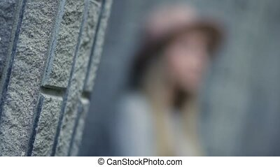Upset thougthful girl smoking cigarette - Closeup view of...