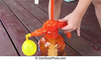 Water Balloon Portable Filling Station in slow motion -...