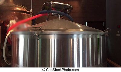 Brewery with beer tanks - Making beer in large brewery tanks