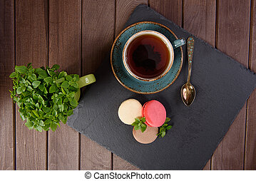 french sweet delicacy, macaroons on wooden background