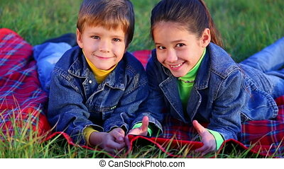 Two kids playing with tablet PC - Two smiling kids playing...