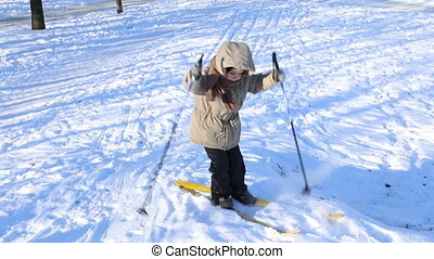two little kids learning to ski