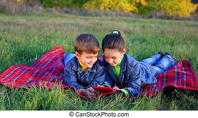 Two kids playing with tablet PC - Two happy kids playing...
