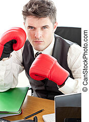 Angry businessman wearing boxing gloves