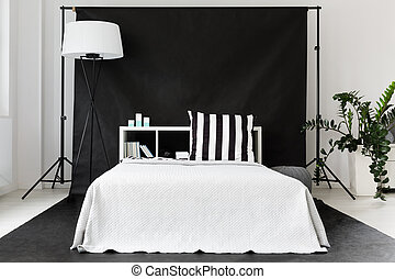 Single man bedroom idea - Modern black and white bedroom...