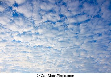 Partly Cloudy Background - Puffy clouds form a mosaic...