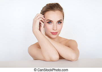 beautiful young woman face and hands - beauty, people and...